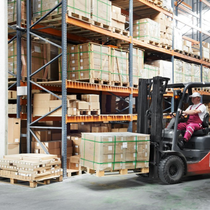 12589732 - worker driver at warehouse forklift loader works